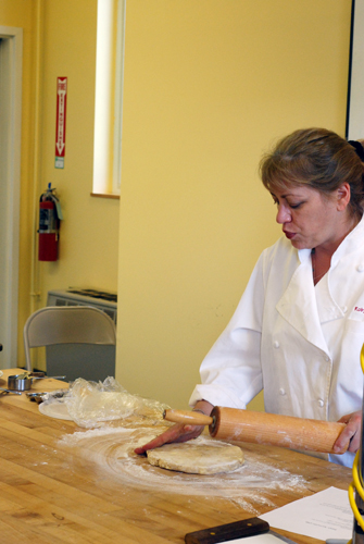 King Arthur Flour baker Robyn rolls out pie crust. Taken at