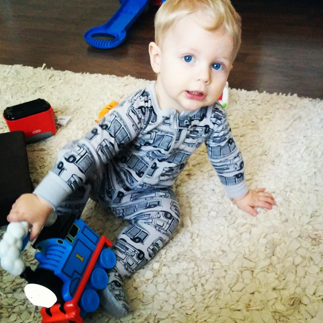 This boy loves his Thomas flashlight. Clattering carriages!
